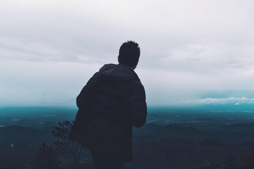 man wears black parka jacket