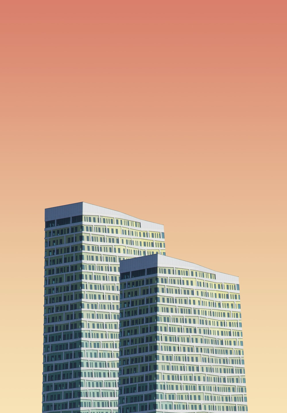 two gray high-rise building illustrations