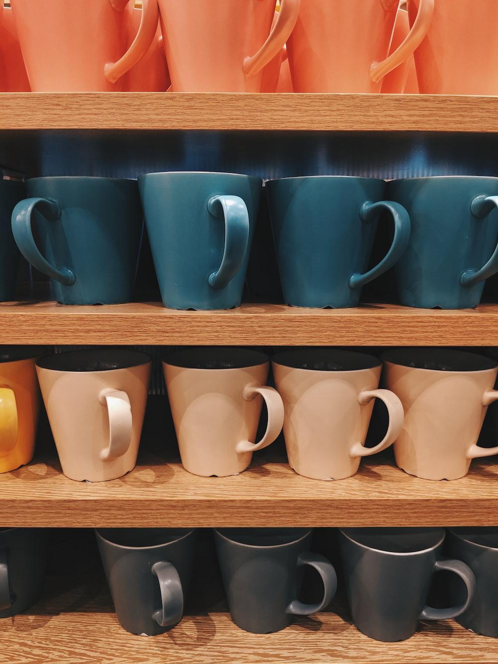assorted-color ceramic mug lot on shelf