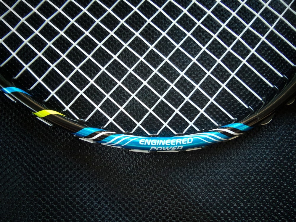 blue and white tennis racket