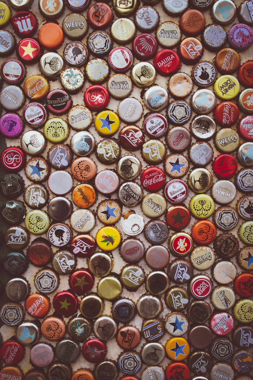 assorted-color-and-label bottle cap lot