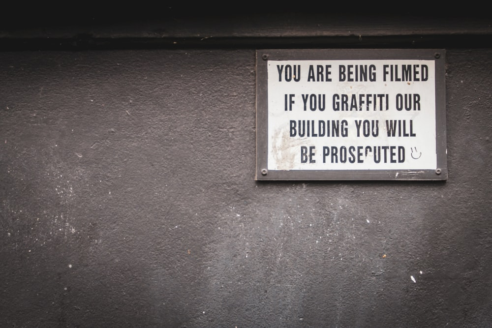 you are being filmed if you graffiti our building you will be prosecuted signage