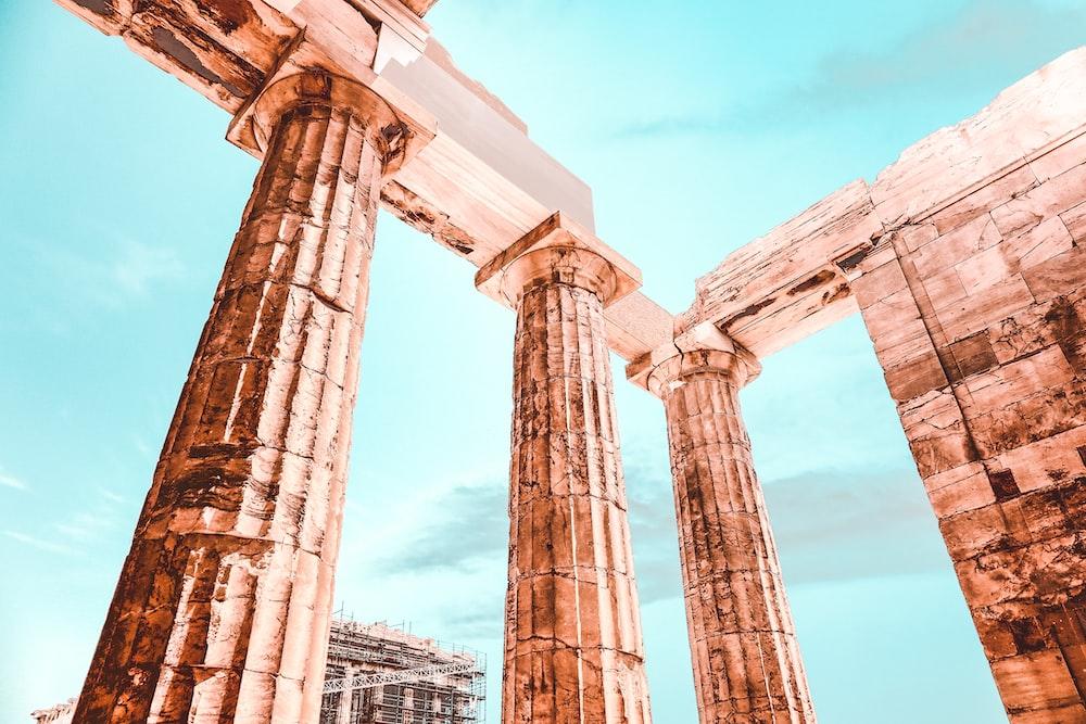 three brown concrete pillars