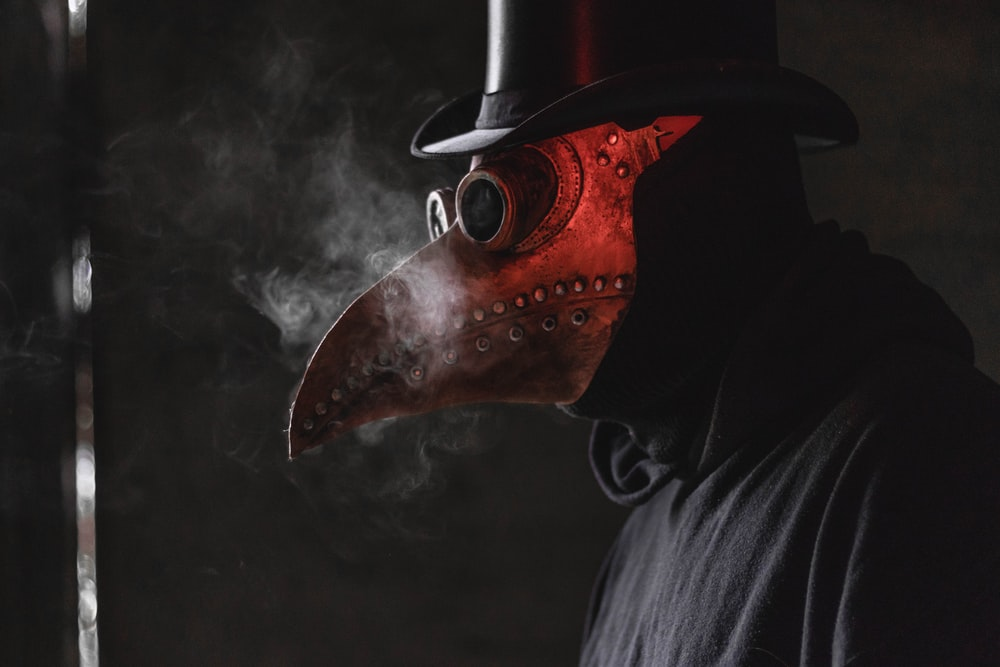 person wears red mask
