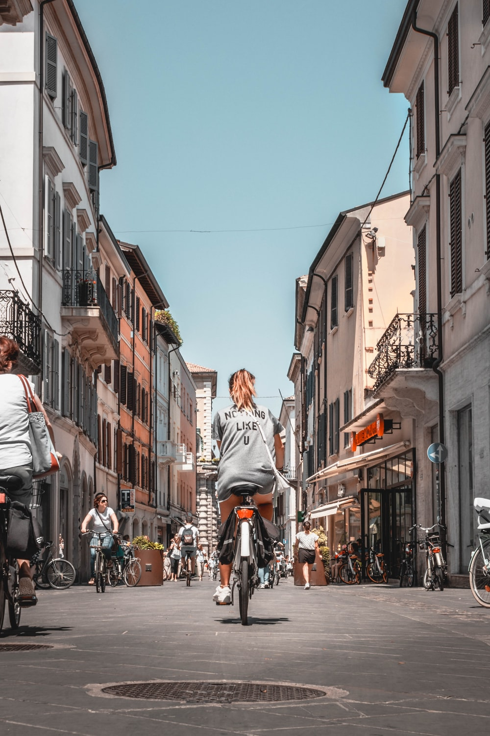 woman riding on bicycle during daytime