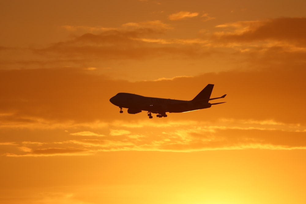 airplane under golden hour skies