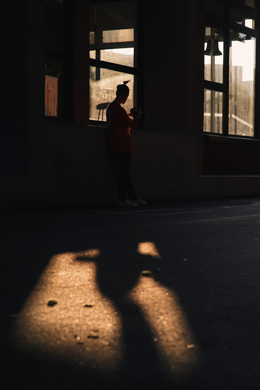 person standing near window