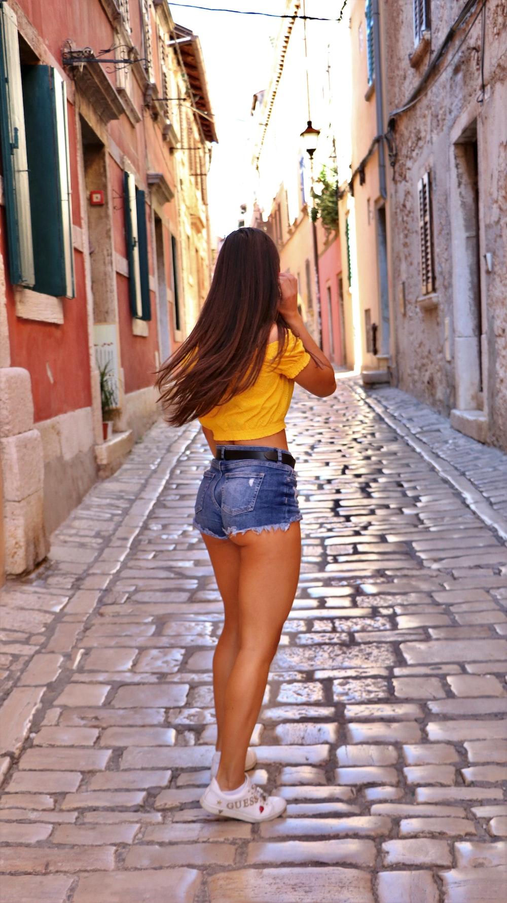 woman in blue denim micro shorts