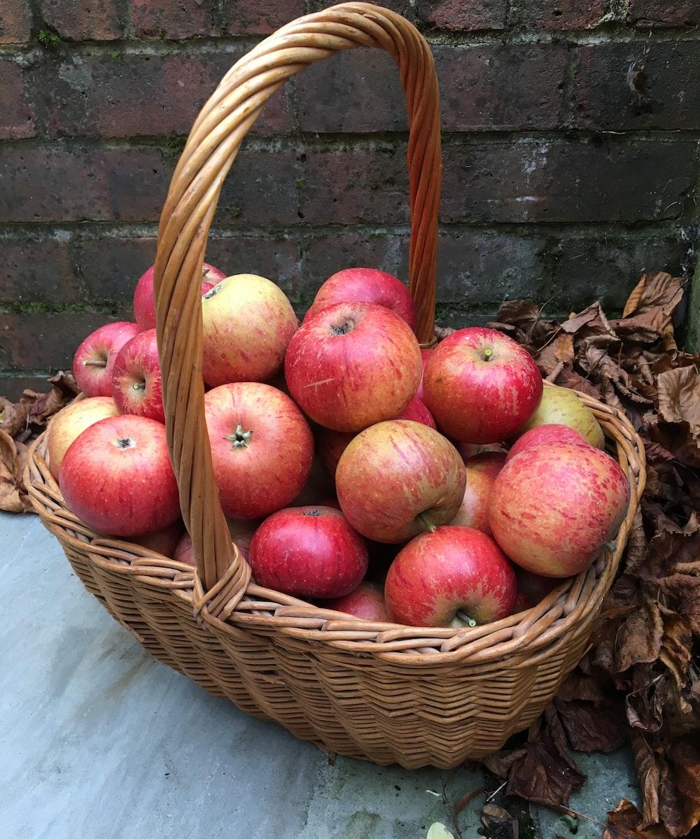 apple fruits in brown wicker basket