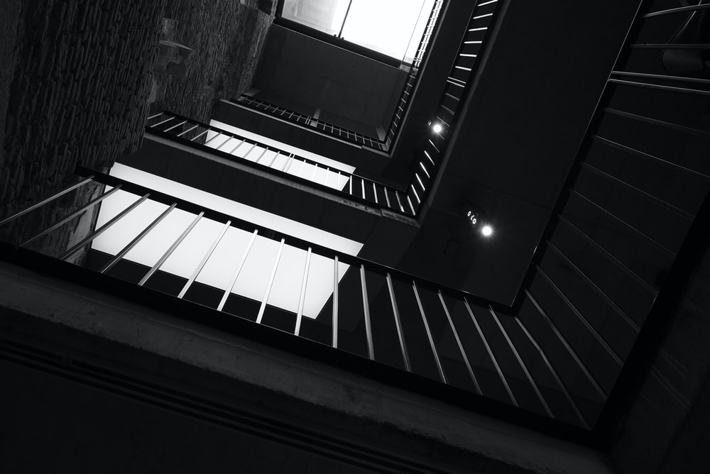low angle photography of grayscale building