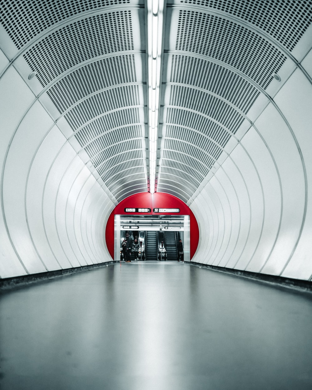 gray and white concrete tunnel