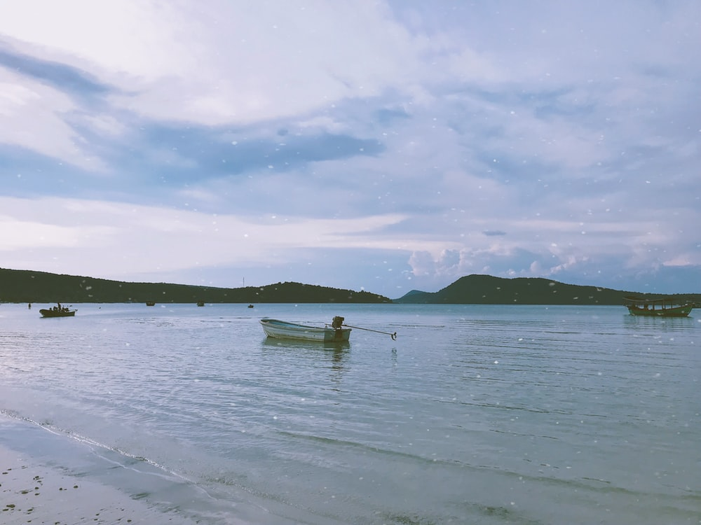 white wooden boat on a beach