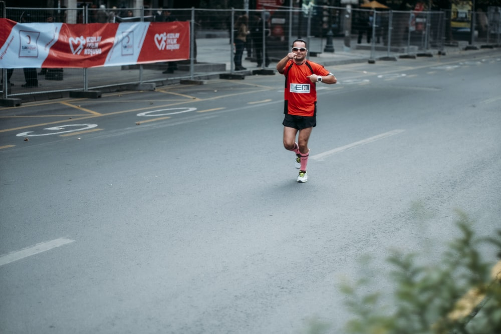 man in red jersey running