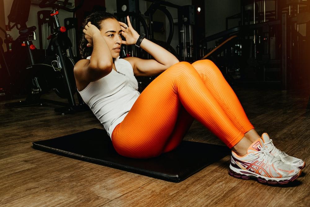exercising woman on mat