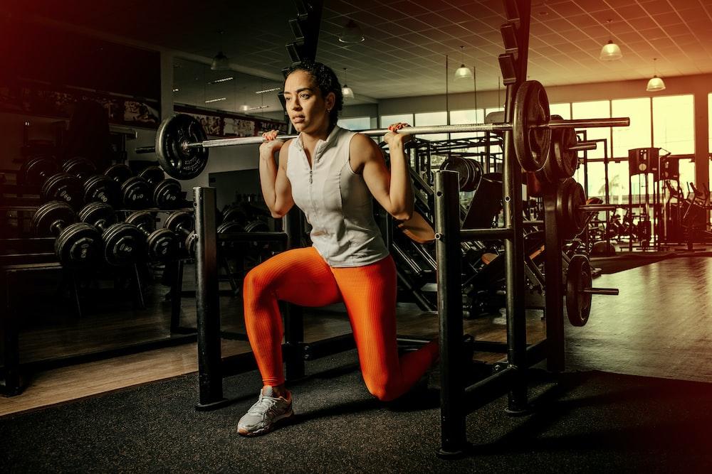 woman wearing gray shirt and orange leggings