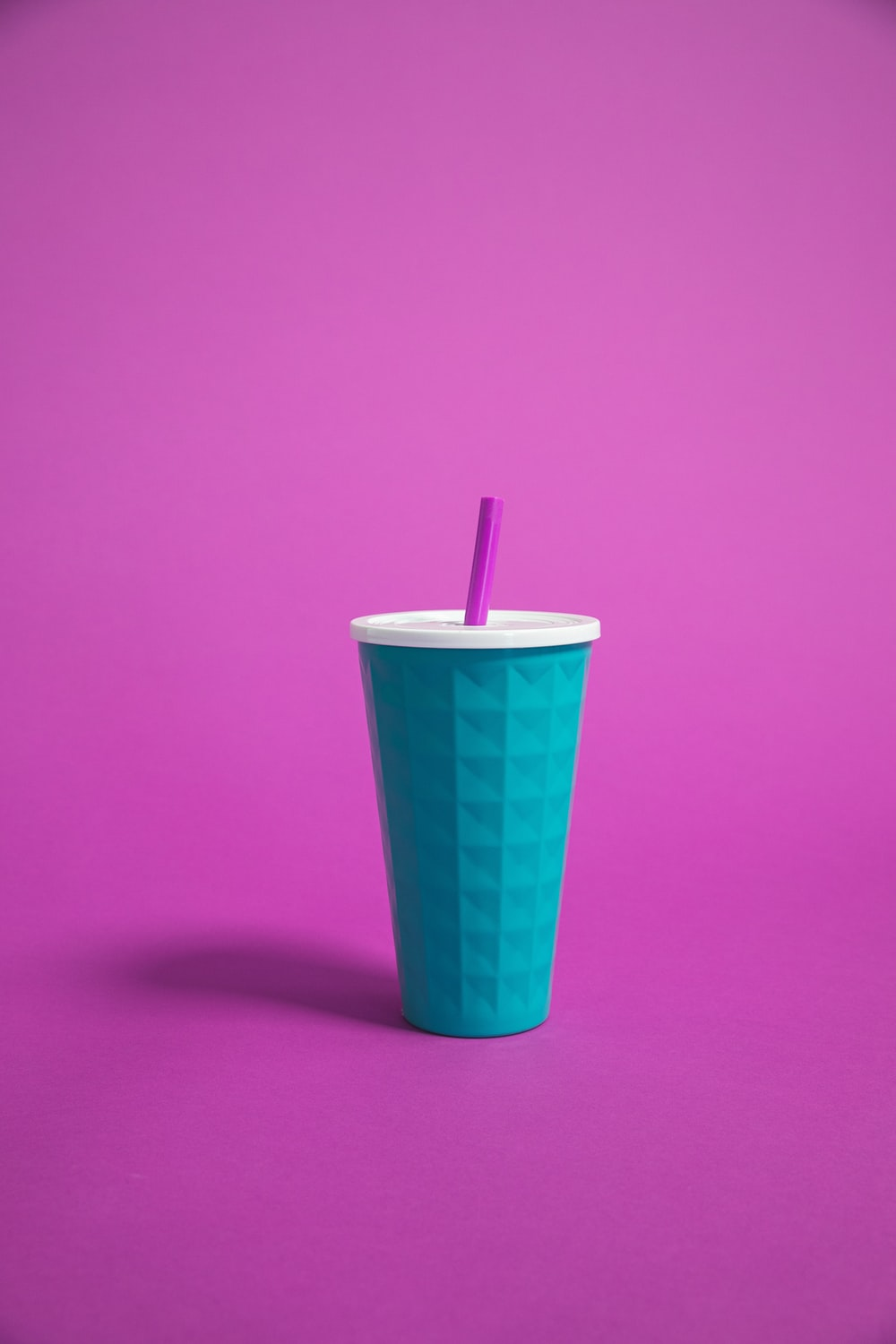blue cup with straw
