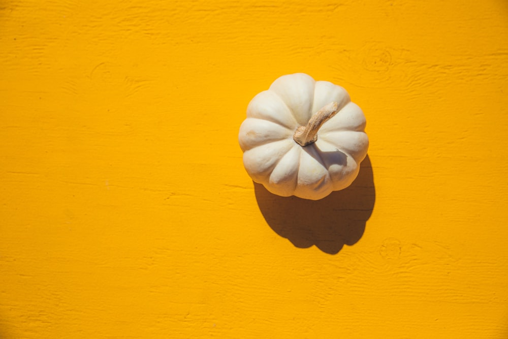 white squash on yellow board