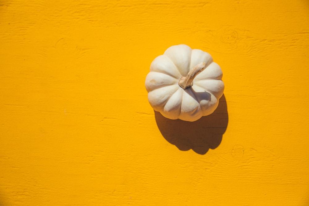 white squash on yellow board