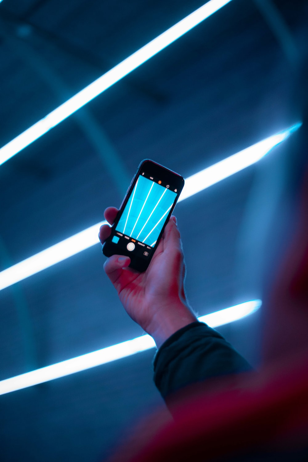 person using smartphone camera displaying lights