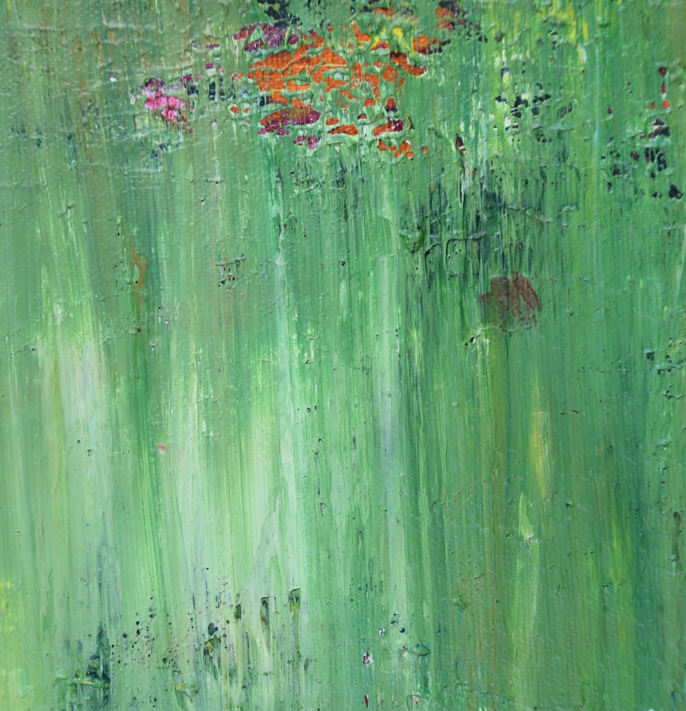 green, pink, and orange abstract painting