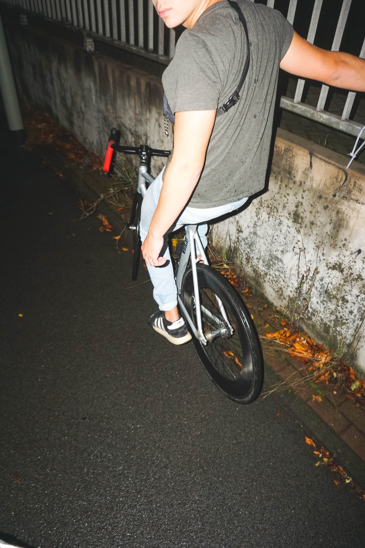 person riding road bike