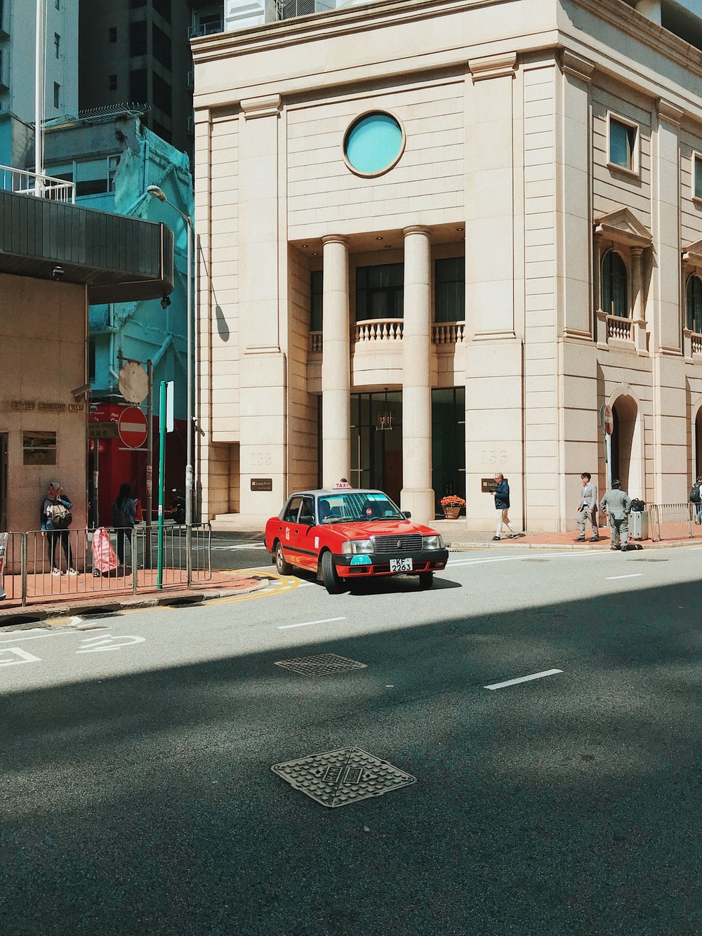 red car near building