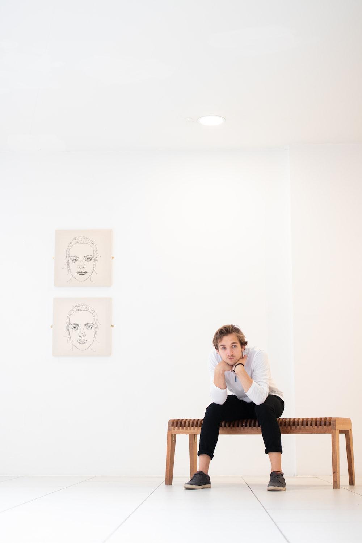sitting man wearing white sweater