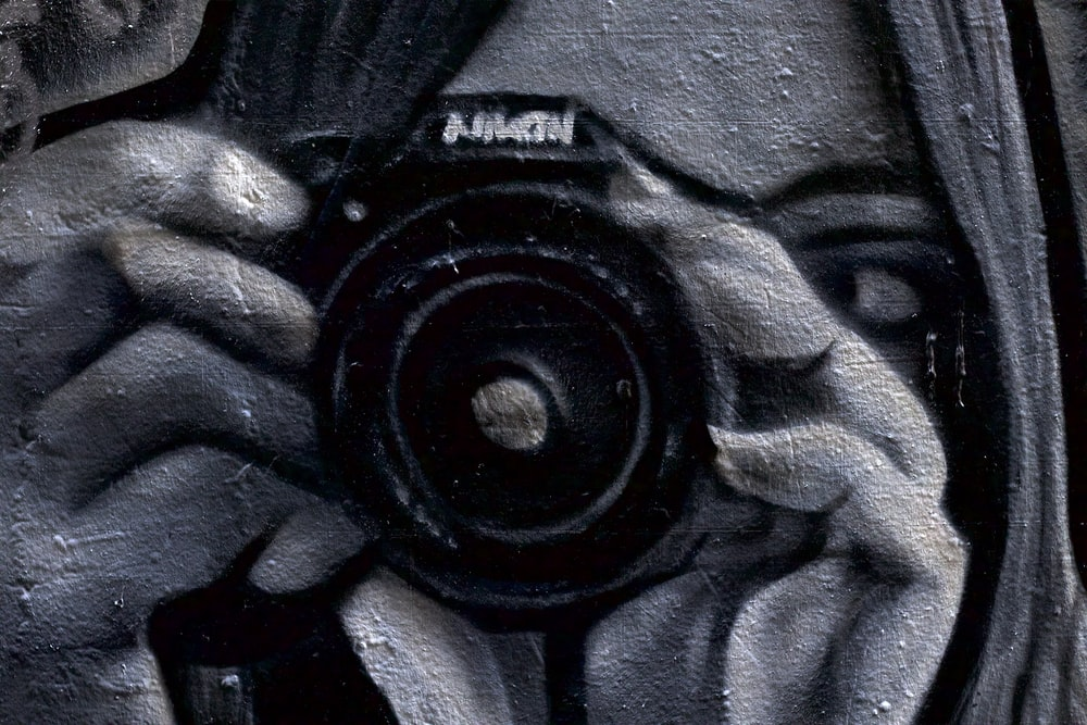 woman using black camera