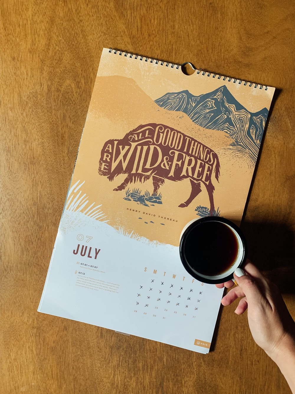yellow and white July calendar