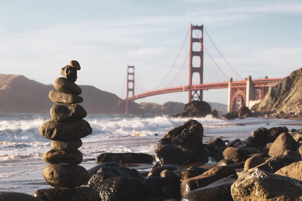cairn stones and Golden Gate Bridge, USA