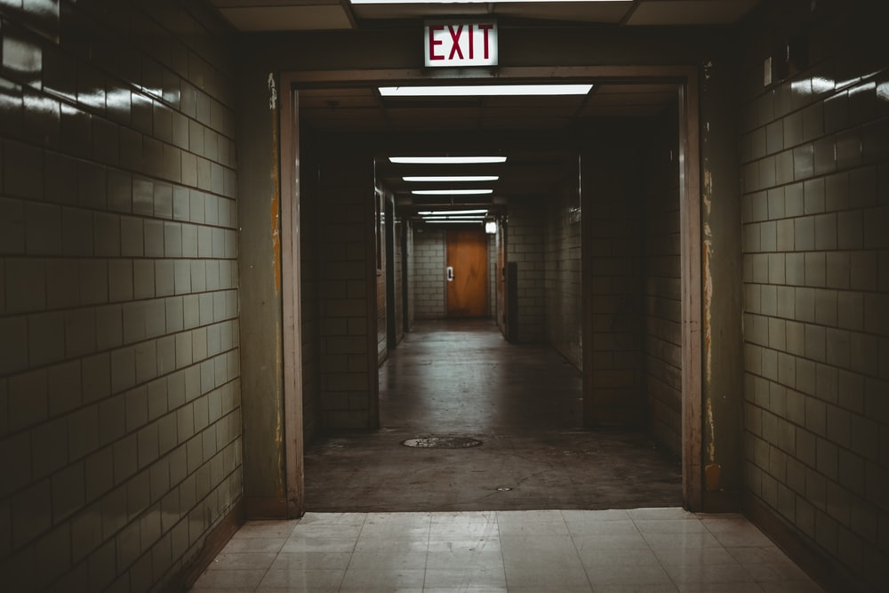 empty hallway with fire exit signage