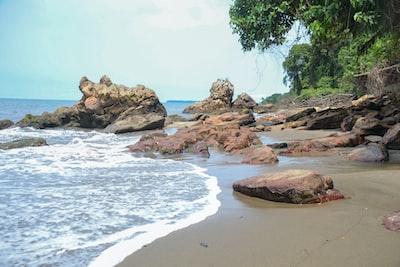 rock formation on seashore gabon zoom background