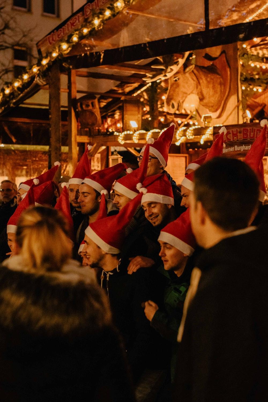 people wearing Santa Claus hat