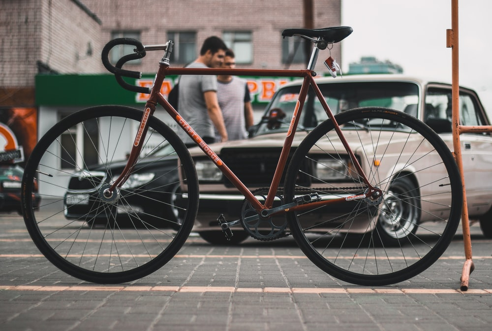 parked red and black road bike