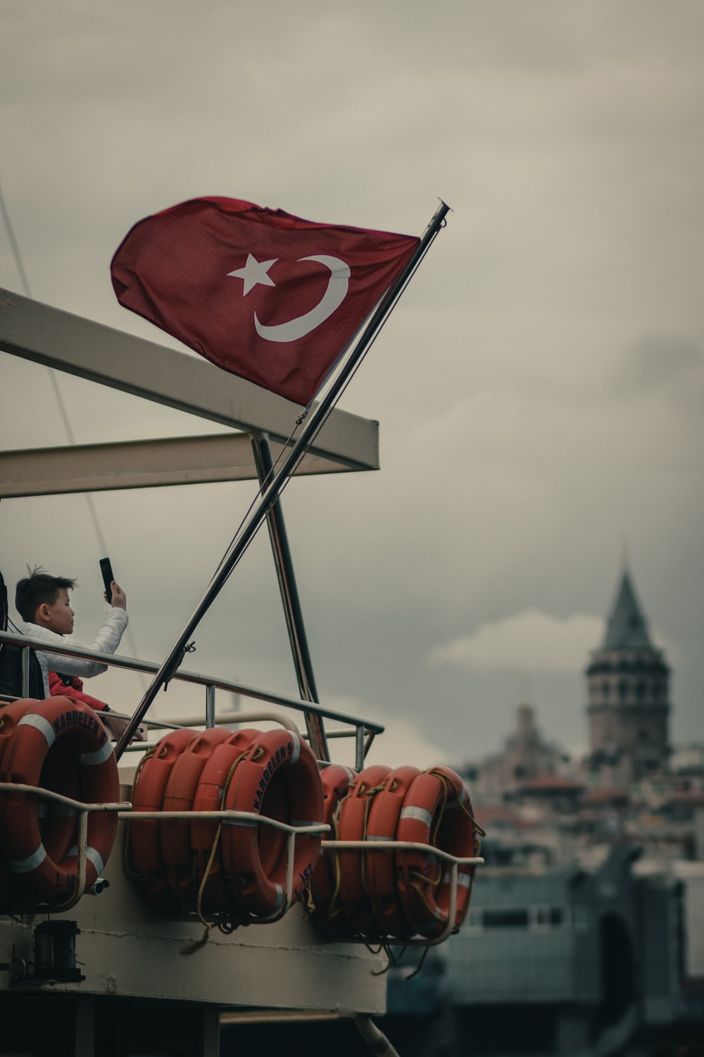 Turkish flag on pole on boat during day