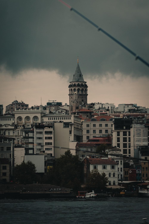 white and black concrete building under gray sky