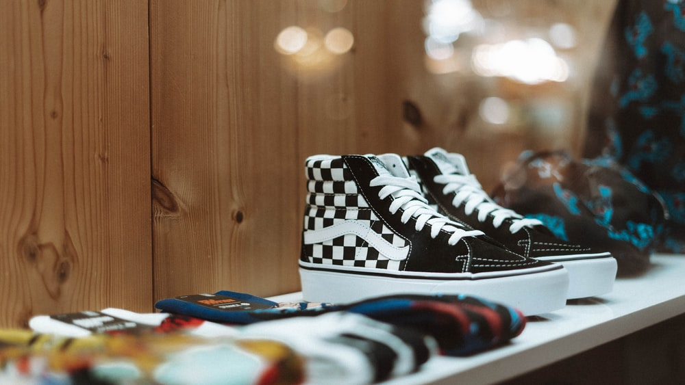 black-and-white Vans checked sneakers