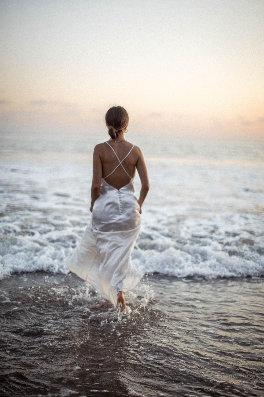 woman in white dress on seashore