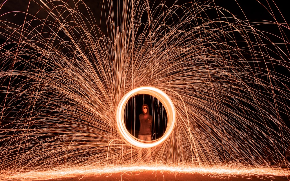 man standing in steel wool photography