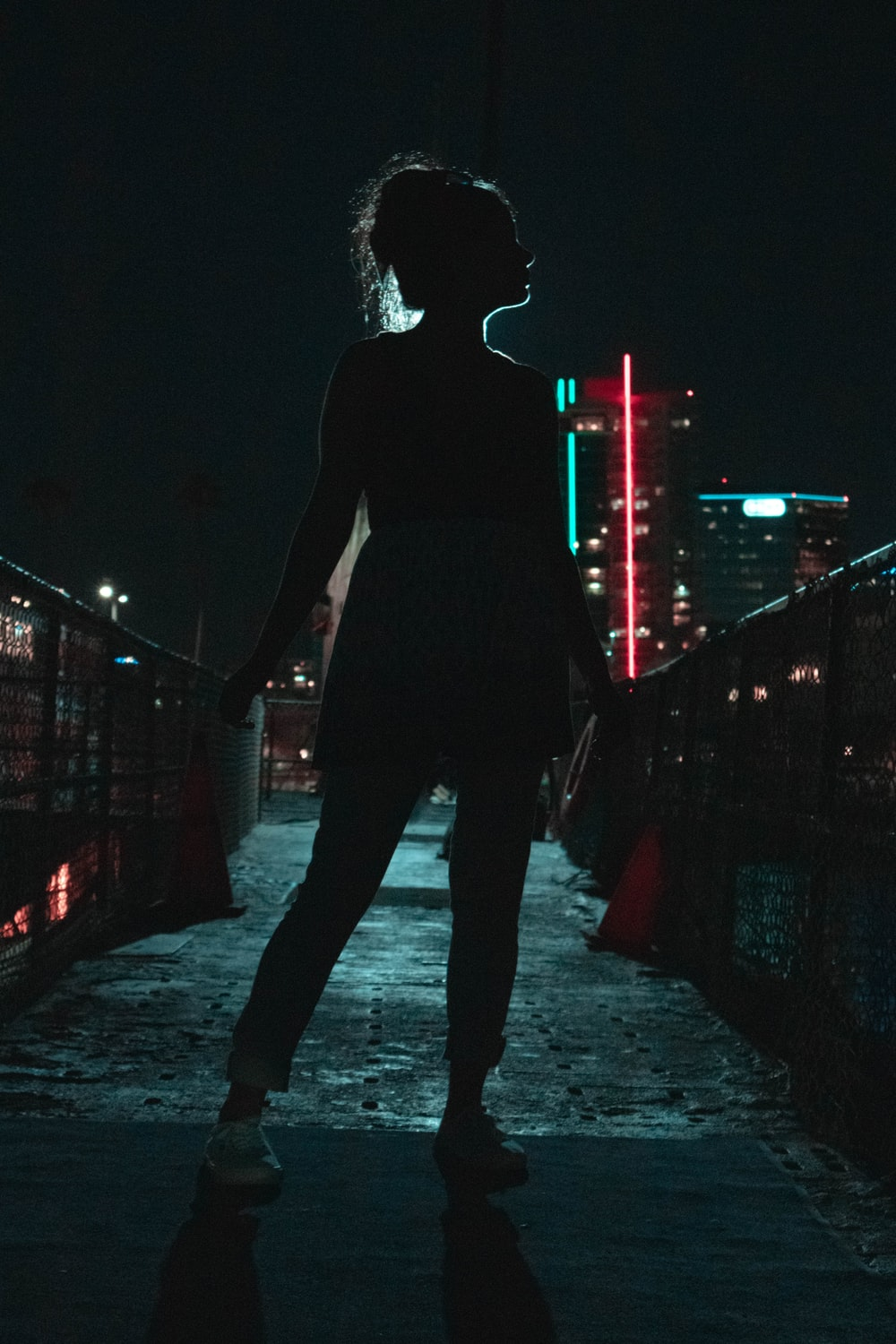 silhouette photography of standing woman