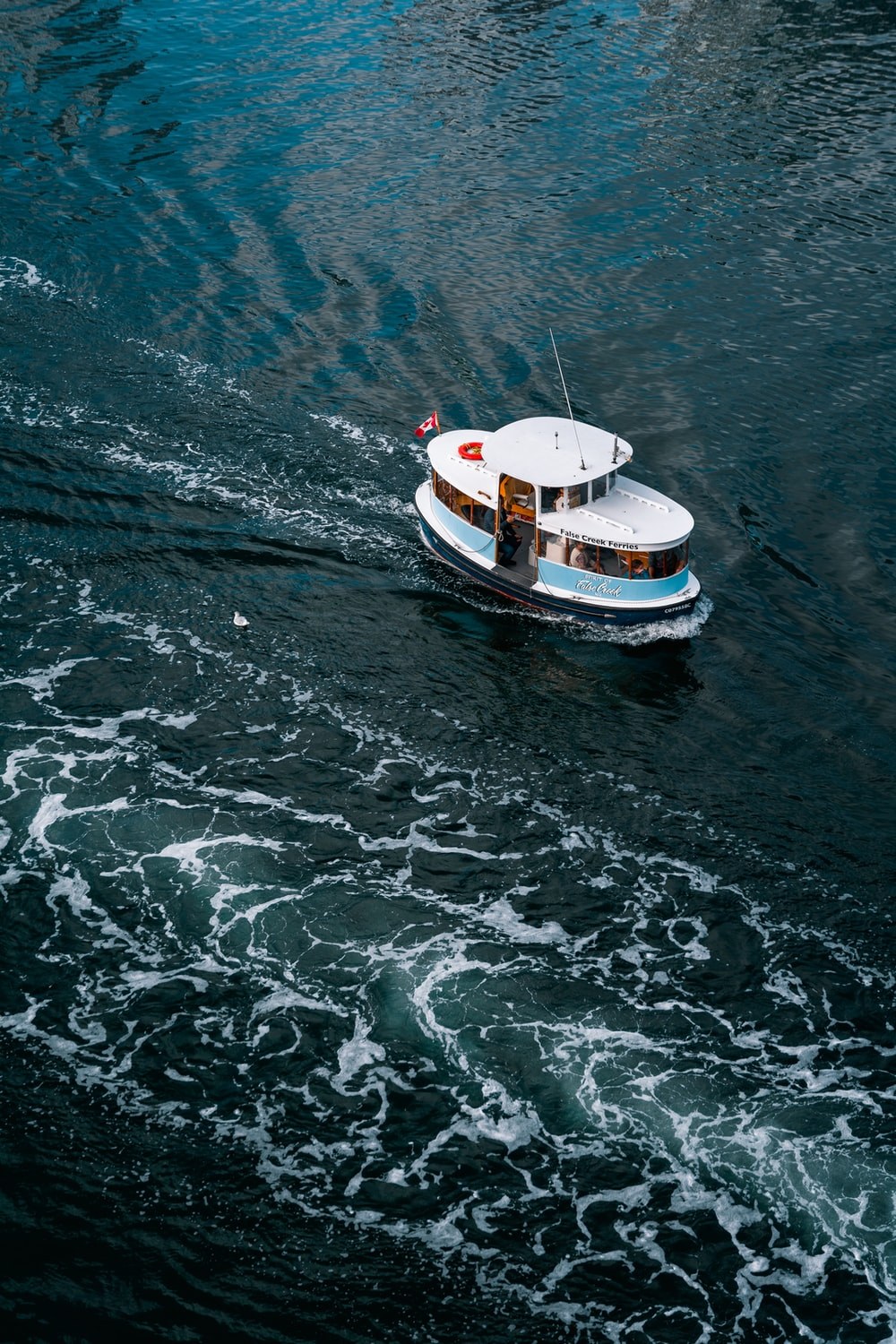 aerial photo of white boat in ocean during daytime