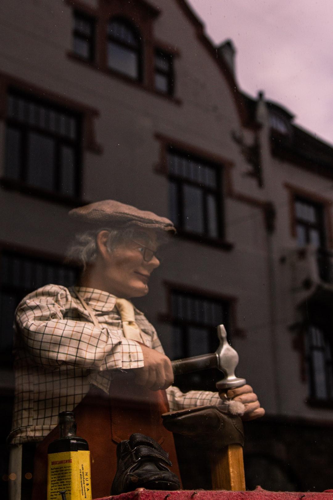 Shoemaker figure in a window