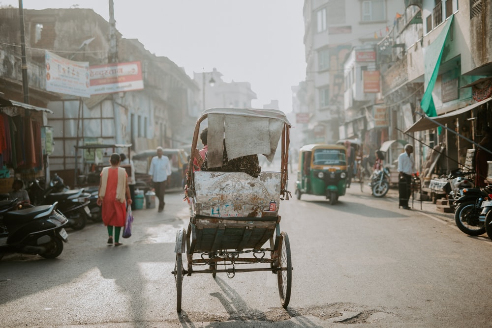 people and vehicle on road