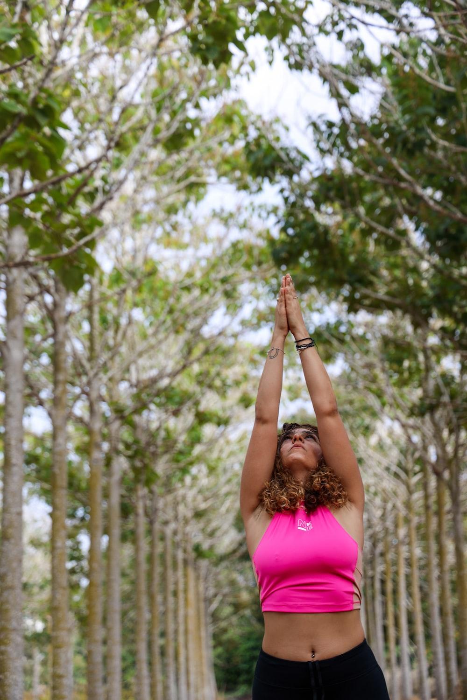 woman wearing pink crop top