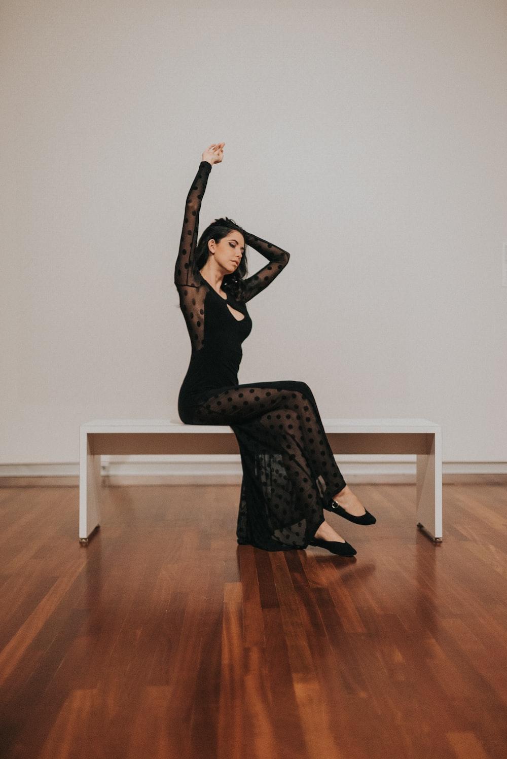 woman in black long-sleeved dress