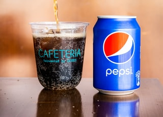 person pouring cup with Pepso soda
