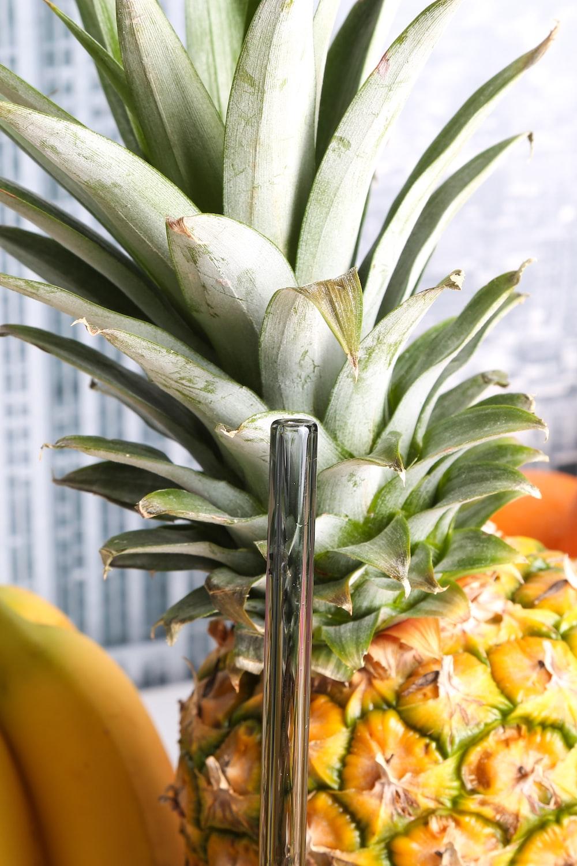pineapple beside bananas