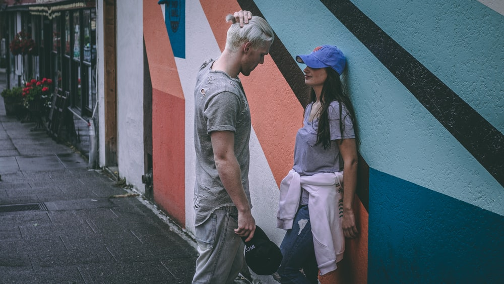 man and woman near wall