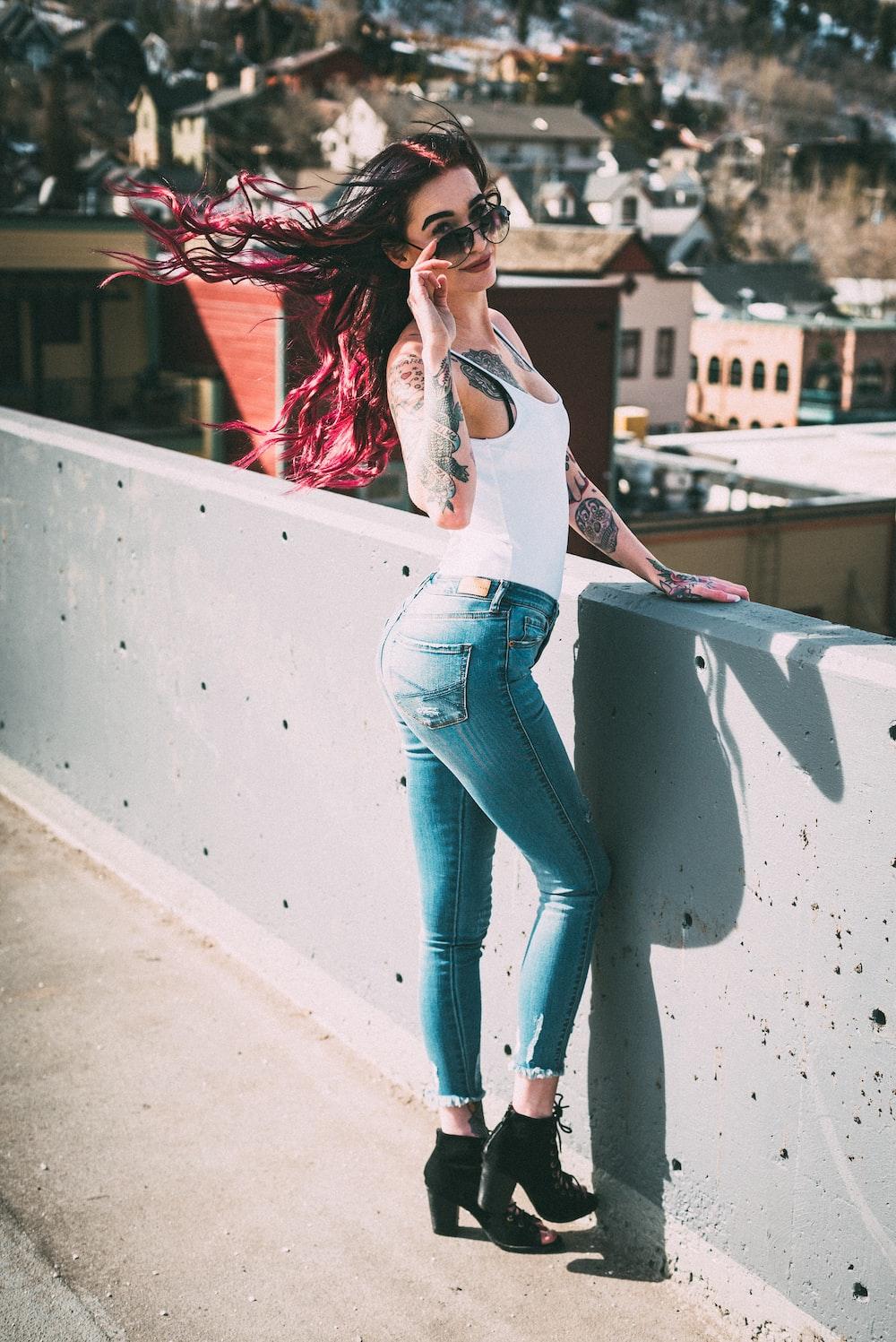 woman standing near concrete rails