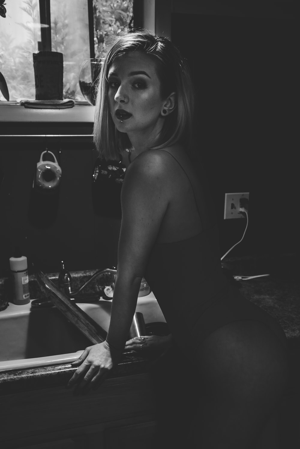 woman standing infront of sink
